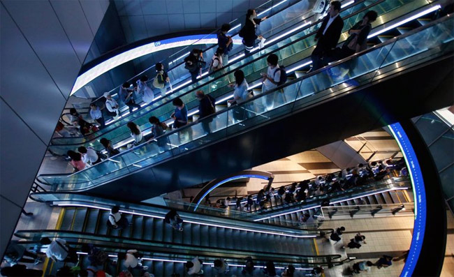 sheeple-masses-escalator-work