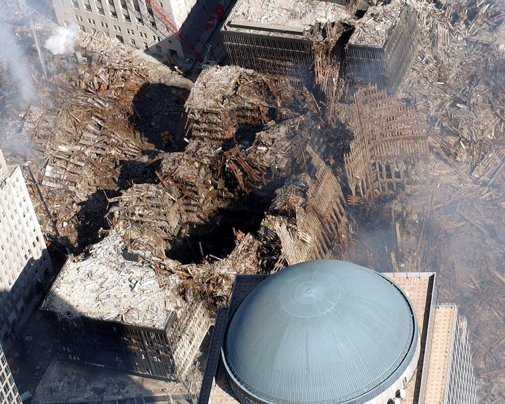 A view over the dome of WFC2 shows the damage to WTC6 in the center of the photo. To the left is the collapsed WTC7.