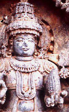 Indiaas beeld met maiskolf in de ene hand.